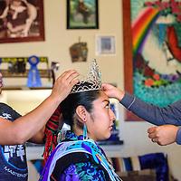 Miss Zuni Tyra Quetawki has her hair crown positioned by her aunt Valerie Martinez, left, and mother Michele Quetawki in Zuni Wednesday.