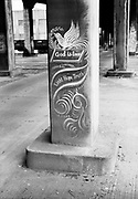 """0001-E207B Lovejoy Columns, Portland, Oregon. Paintings on the pillars of the old Lovejoy Ramp created by Greek Immigrant and Artist Tom Stefopoulos from 1948 to 1952. Larry Smith made these photos to propose a newspaper article titled """"God Is Love"""" named after one of the paintings, May 1954."""
