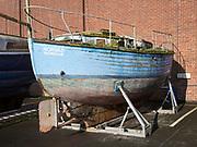 Old rotting boat Ipswich Wet Dock waterside redevelopment, Ipswich, Suffolk, England, Uk