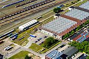 Nederland, Utrecht, Amersfoort, 17-07-2017;<br /> Stationswijk Soesterkwartier, spoorweg emplacement Amersfoort, met rangeerterrein en gebouwen van de voormalige Wagenwerkplaats.<br /> Railway yard Amersfoort, with yard and workshop buildings.<br /> <br /> luchtfoto (toeslag op standard tarieven);<br /> aerial photo (additional fee required);<br /> copyright foto/photo Siebe Swart