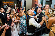 A bride and groom at their reception held at the Watermark in Asbury Park, New Jersey.
