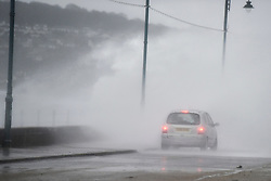 © Licensed to London News Pictures.03/02/2017. A car is showered in waves battering the coastline at  Penzance in Cornwall as the unofficially named storm DORIS hits the UK coast. Photo credit : Mark Hemsworth/LNP