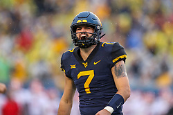 Sep 8, 2018; Morgantown, WV, USA; West Virginia Mountaineers quarterback Will Grier (7) celebrates after throwing for a touchdown during the second quarter against the Youngstown State Penguins at Mountaineer Field at Milan Puskar Stadium. Mandatory Credit: Ben Queen-USA TODAY Sports