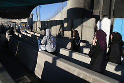 June 23, 2017 - Ramallah, West Bank, Palestinian Territory - Palestinians going to pray at the al-Aqsa mosque compound in Jerusalem make their way through the Israeli Qalandia checkpoint, in the occupied West Bank between Ramallah and Jerusalem, during the last Friday of the holy fasting month of Ramadan on June 23, 2017  (Credit Image: © Stringer/APA Images via ZUMA Wire)