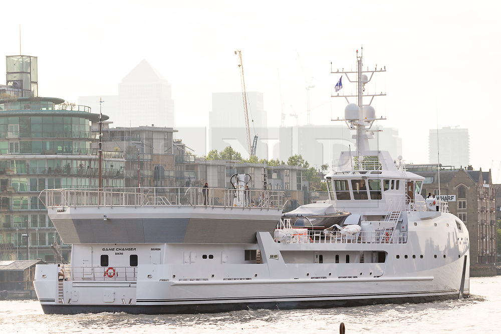© Licensed to London News Pictures. 18/05/2017. LONDON, UK.  The Game Changer, a newly built superyacht support vessel leaves London just after passingunder Tower Bridge on the River Thames after her first visit to the capital. The 70-meter superyacht support vessel has a large helideck so that yacht owners can take larger helicopters on long range flights to their mother yachts and 250 square metres of open deck space for tenders and toys, plus offices, facilities and accommodation for 22 crew and staff below deck. Built by Dutch Shipbuilder, Damen, the Game Changer was launched in March this year and recently completed sea trials in the North Sea. Photo credit: Vickie Flores/LNP