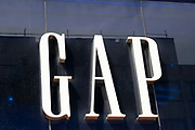 Sign for the American clothing company GAP on 2nd July 2021 in London, United Kingdom. The US fashion store Gap has confirmed it plans to close all of its 81 stores in the UK and Ireland to go online-only from Autumn.