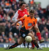 Photo. Daniel Hambury.<br /> Arsenal v Sheffield United. <br /> FA Cup Fifth Round.<br /> 19/2/2005.<br /> Arsenal's Robert Pires with Sheffield United's Jon Harley.