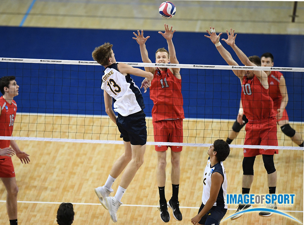 Ohio State Buckeyes outside hitter Maxime Hervoir (10) and middle blocker Blake Leeson (11) block a shot by UC Irvine Anteaters middle blocker Scott Stadick (13) during the opening round game of the NCAA college volleyball championship in Los Angeles, Tuesday, May 1, 2018. Ohio State defeated UC Irvine 25-19, 22-25, 25-23, 22-25, 16-14.
