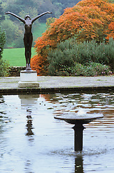 The Italian garden at Borde Hill with formal rectangular pond and statue.