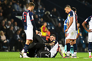 West Bromwich Albion midfielder Alex Mowatt (27) receives treatment during the EFL Sky Bet Championship match between West Bromwich Albion and Derby County at The Hawthorns, West Bromwich, England on 14 September 2021.