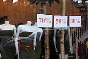 70%, 50%, 30% - take your pic for these fine fashionable headless mannequins in a shop window off Leidsestraat, Amsterdam. Bonus: trendy car and Amsterdam houses. December 2010
