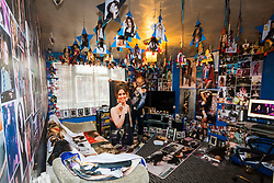 Shaun Smith, 52, from Basildon in Essex, displays a towel he had made bearing his idol's image in his home, which is a temple to Cheryl Cole. He has built up a huge collection of Cheryl Cole memorabilia in the space of about eight months, spending over £7,000 on his collection after she impressed him in a music video he was watching.. PLACE, January 24 2019.