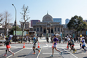 Supporters line the streets of Tsukiji to watch runners during the 10th Tokyo Marathon took place on a fine spring day in Tokyo Japan. Sunday February 28th 2016. Thirty-six thousand runners took part with Ethiopian,  Feyisa Lilesa winning the  men's competition and  Kenyan, Helah Kiprop victorious in the women's race.