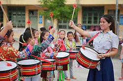 LIUZHOU, Sept. 7, 2016 (Xinhua) -- Liang Haihuan (1st R), a rural primary school teacher, teaches her students playing drums in Gaoma Village Primary School, where most students are ''left-behind children'', in Liuzhou, south China's Guangxi Zhuang Autonomous Region. The phrase is used in China to describe rural children whose parents work in other cities. Left-behind children usually live with relatives, often their grandparents, while their parents work away from home. . (Xinhua/Long Tao) (wyl) (Credit Image: © Long Tao/Xinhua via ZUMA Wire)
