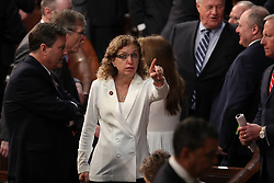 United States Representative Debbie Wasserman-Schultz (Democrat of Florida) points towards the gallery from the floor prior to US President Donald J. Trump delivering his second annual State of the Union Address to a joint session of the US Congress in the US Capitol in Washington, DC on Tuesday, February 5, 2019. She is wearing white in response to Representative Lois Frankel's call to acknowledge the voters who handed Democrats a majority in the House in the midterm elections and a reminder that they plan to make women's economic security a priority. Photo by Alex Edelman/CNP/ABACAPRESS.COM