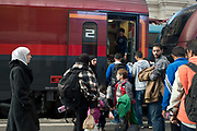 Hungary, Budapest, Keleti Station. Refugees wait for trains to Austria and Germany. Syrian refugees get on a train for the Austrian border.