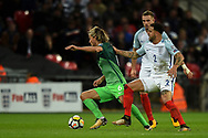 Slovenia midfielder Rene Krhin  and England defender Kyle Walker during the FIFA World Cup Qualifier match between England and Slovenia at Wembley Stadium, London, England on 5 October 2017. Photo by Martin Cole.
