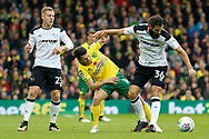 Norwich City midfielder Wesley Hoolahan (14) battles for possession with Joe Ledley during the EFL Sky Bet Championship match between Norwich City and Derby County at Carrow Road, Norwich, England on 28 October 2017. Photo by Phil Chaplin.