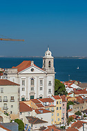 The Alfama of Lisbon, with The Tagus River in the background.