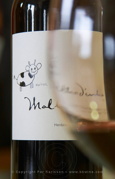 Bottle of Malhadinha. Drawing by Matilde. Seen through a glass. Herdade da Malhadinha Nova, Alentejo, Portugal