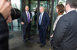 © London News Pictures. 29/10/2013 . London, UK. Chairman of Soros Fund Management, George Soros (centre), arriving at Portcullis House in Westminster, central London. Photo credit : Ben Cawthra/LNP