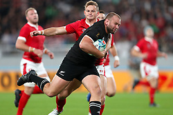 New Zealand's Joe Moody holds off Wales' Hallam Amos to scores his sides first try during the 2019 Rugby World Cup bronze final match at Tokyo Stadium.