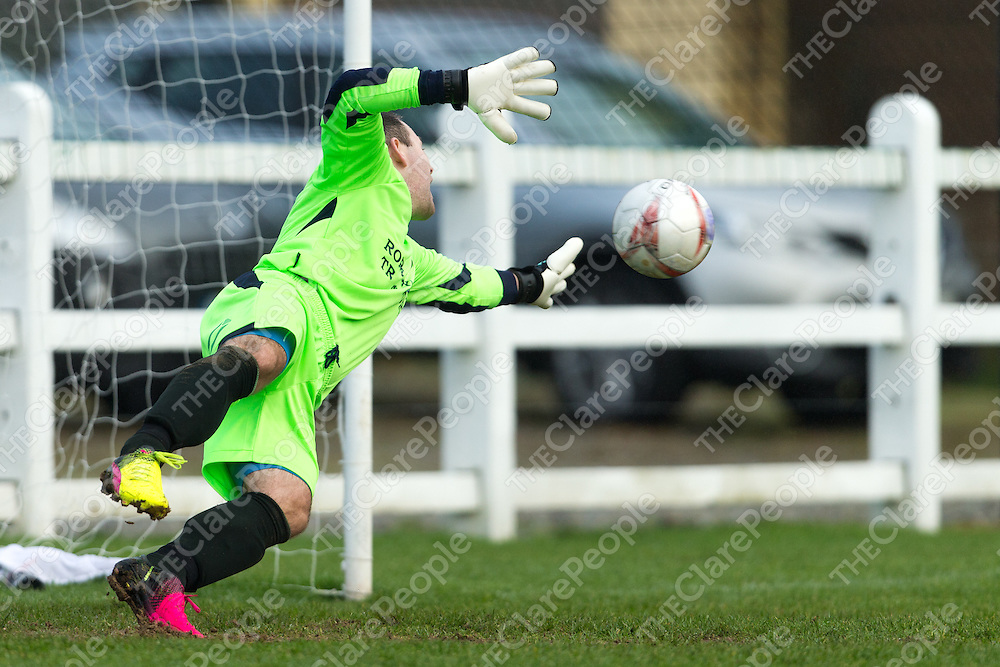 Shannon Town's Keeper Darren Whelan stretches to save a goal