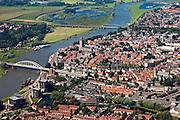 Nederland, Overijsssel, Deventer, 06-09-2010; IJssel, met de wijk het Pothoofd in de voorgrond. In het midden de binnenstad met Sint-Lebuïniskerk. Op de westelijke (linker) IJsseloever, tussen beide bruggen, de wijk De Hoven (of de Worp), in kader van Ruimte voor de Rivier moet hier een hoogwatergeul aangelegd worden.IJssel, with the district Pothoofd in the foreground. In the town centre St. Lebuïniskerk. On the western (left) shore, between the two bridges, a flood channel will be build to reduce the water level during heigh waters.luchtfoto (toeslag), aerial photo (additional fee required).foto/photo Siebe Swart