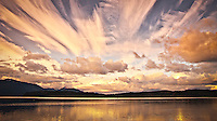 Evening alpenglo colored clouds cross the sky in a panorama of the Hood Canal and Toandos Peninsula as viewed from the Kitsap Peninsula in Puget Sound, Washington, USA.