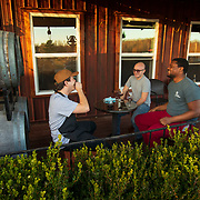 Conner Leaderbrand, left, Elijah Goodman and Matthew Mercer talk while drinking wine at the Owen Valley Winery outside of Spencer, Indiana. Nathan Lambrecht/Journal Communications