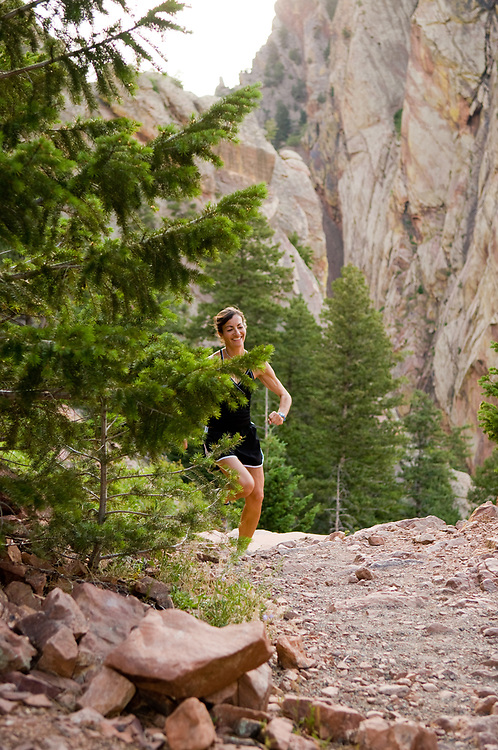 Woman trail running in Boulder, CO