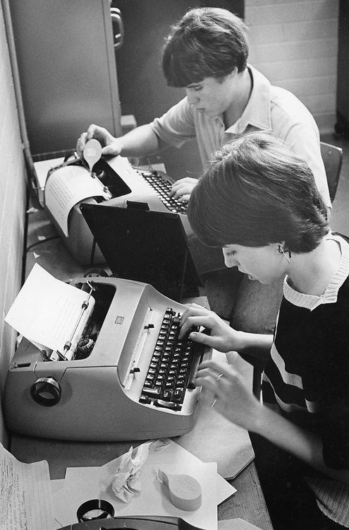 ©1988 students working on school newspaper, Austin, Texas with IBM Selectric typewriters.