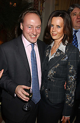 ANDREW ROBERTS and SUSAN GILCHRIST at The Business Winter Party hosted by Andrew Neil at The Ritz Hotel, Piccadilly, London on 7th December 2005.<br /><br />NON EXCLUSIVE - WORLD RIGHTS