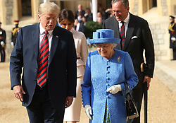 Queen Elizabeth II, US President Donald Trump and his wife Melania walk from the Quadrangle after inspecting an honour guard at Windsor Castle, Windsor.