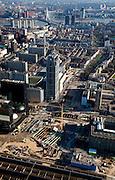Nederland, Zuid-Holland, Rotterdam, 20-03-2009; Stationsplein, aanleg Rotterdam Centraal, nieuw station ook wel OV-terminal (of OV-knooppunt). Vervanging en uitbreiding van het oude Centraal Station (onder in beeld)  was noodzakelijke omdat in de toekomst ook HSL-Zuid en RandstadRail van het nieuwe vervoersknooppunt gebruik zullen maken. In het midden de Weena-toren, met rechts daar van de Culturle As (Kruisplein - Mauritsweg en Westersingel). Kop van Zuid en Erasmusbrug in de verte. Air view on the center of Rotterdam, the replacement and enlargement of the old Central Station of Rotterdam (bottom), in connection with the HSR. Top of pic the river Meuse (Maas) and the Erasmus Bridge..Swart collectie, luchtfoto (toeslag); Swart Collection, aerial photo (additional fee required).foto Siebe Swart / photo Siebe Swart