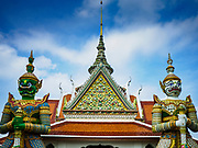 """11 SEPTEMBER 2017 - BANGKOK, THAILAND: Hanuman, the Monkey God, guards the main entrance to Wat Arun. Renovations are nearly finished at Wat Arun on the Thonburi side of the Chao Phraya River in Bangkok. Wat Arun is famous for its Khmer style main """"prang"""" (chedi). It was originally built in the Ayutthaya Period and rebuilt to its current form in the time of Rama II.       PHOTO BY JACK KURTZ"""