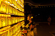 Japanese women in kimono enjoy the spectacular lanterns display during the Mitama matsuri at the controversial Yasukuni Shrine in Kudanshita, Tokyo, Japan. Friday July 14th 2017. The Mitama Matsuri is one of Japan's largest Obon festivals with over 300,000 visiting the shrine to pay respect to ancestors during the 4 days it lasts. Obon is festival of remembrance for ancestors who are believed to come back from the other world and visit the living at this time. Yasukuni Shrine, which houses the spirits of the Japanese war dead, celebrates these spirits with 30,00 yellow lanterns and mikoshi parades and traditional dancing. The festivals runs from July 13th to 16th.