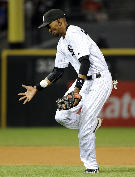 CHICAGO - JUNE 06:  Alexei Ramirez #10 of the Chicago White Sox bobbles a ball hit by Greg Halman #56 of the Seattle Mariners in the eighth inning on June 6, 2011 at U.S. Cellular Field in Chicago, Illinois.  The White Sox defeated the Mariners 3-1.  The ball was ruled a hit.  (Photo by Ron Vesely)  Subject:  Alexei Ramirez;Greg Halman