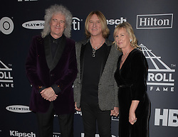 March 30, 2019 - Brooklyn, New York, USA - NEW YORK, NEW YORK - MARCH 29: Brian May of Queen, Inductee Joe Elliott of Def Leppard, and Kristine Elliott attends the 2019 Rock & Roll Hall Of Fame Induction Ceremony at Barclays Center on March 29, 2019 in New York City. Photo: imageSPACE (Credit Image: © Imagespace via ZUMA Wire)