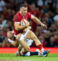 Gareth Davies of Wales is tackled by Willi Heinz of England<br /> <br /> Photographer Simon King/Replay Images<br /> <br /> Friendly - Wales v England - Saturday 17th August 2019 - Principality Stadium - Cardiff<br /> <br /> World Copyright © Replay Images . All rights reserved. info@replayimages.co.uk - http://replayimages.co.uk