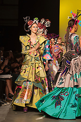 © Licensed to London News Pictures. 22/05/2014. London, England. Pictured: Collection by Mary Benson with headpieces by Lara Jensen. Graduate fashion show at the University of Westminster. 16 Students of the Fashion Design BA (Hons) course presented their final collections in a runway show at P3. Photo credit: Bettina Strenske/LNP