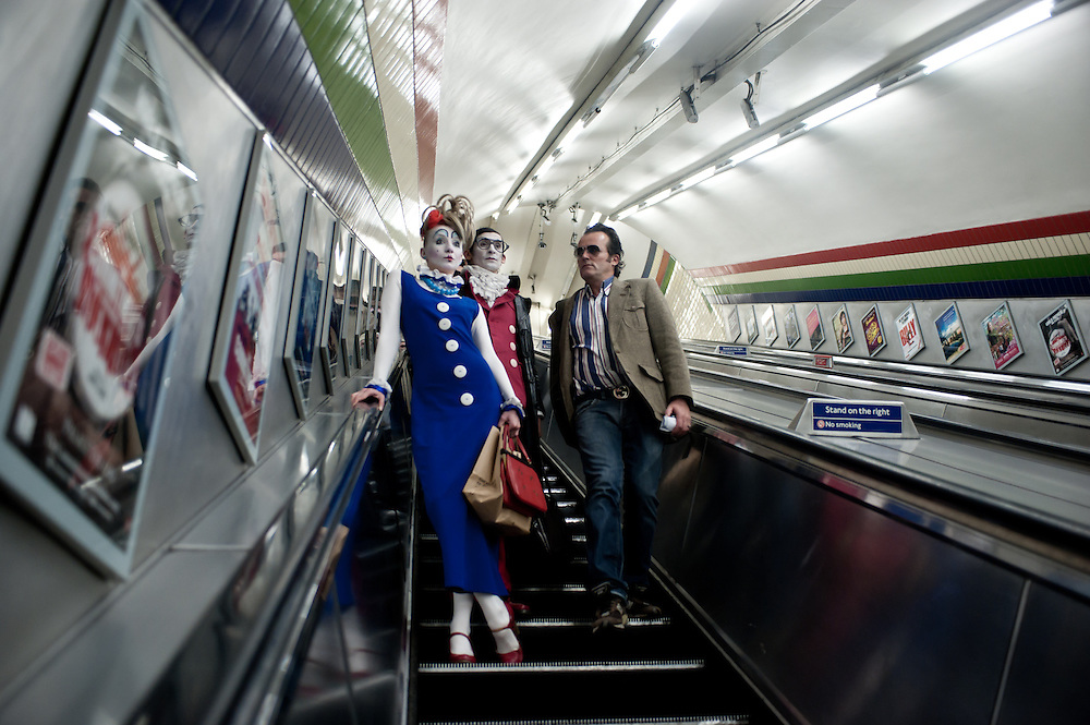London, UK - 24 October 2013: a curious commuter on a tube escalator looks at Ekaterina Voevodkina (L) and Pavel Ivanov (R) on their way to a day out in London.