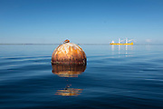 Buoy in Port Angeles harbor on a very calm day.