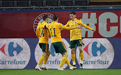 LEUVEN, BELGIUM - Wednesday, March 24, 2021: Wales' Harry Wilson (R) celebrates after scoring the first goal with team-mates captain Gareth Bale (C) and Connor Roberts (L) during the FIFA World Cup Qatar 2022 European Qualifying Group E game between Belgium and Wales at the King Power Den dreef Stadium. Belgium won 3-1. (Pic by Vincent Van Doornick/Isosport/Propaganda)