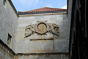 Coat-of-arms and carved inscription, Sponza Palace, Dubrovnik old town, Croatia