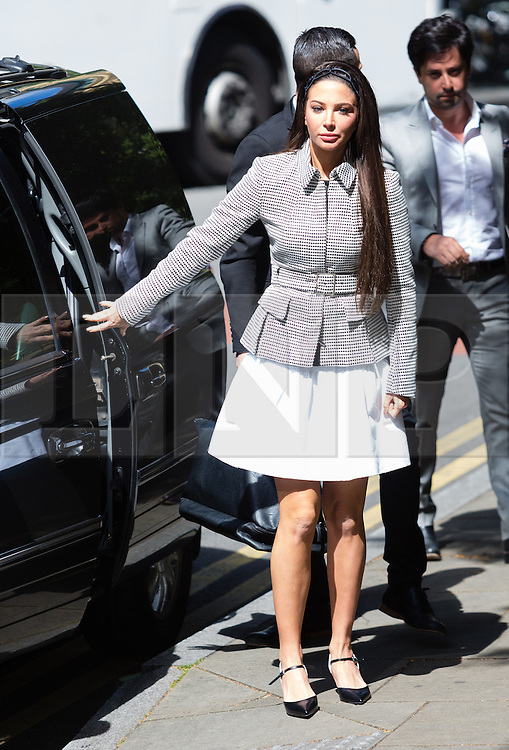 © Licensed to London News Pictures. 25/06/2014. London, UK. Former X Factor judge, Tulisa Contostavlos arrives at Southwark Crown Court in London on 25th January 2014 ahead of her trial scheduled for next month. Contostavlos has been charged with being concerned in the supply of Class A drugs but her lawyers argue the case against her should be thorn out because she was the victim of entrapment and will be unable to have a fair trial.  Photo credit : Vickie Flores/LNP