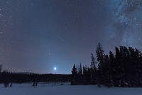 After the sun set over the Absaroka Mountains, Venus became brighter and the zodiacal light began to glow vividly all around it. The diffuse, diagonal glow is caused by the sun illuminating dust particles within the solar system. I shot a couple hundred images for a time lapse and caught a meteor in one of them.