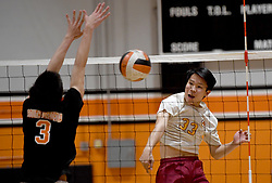 April 30, 2019 - South Pasadena, California, U.S. - Brandon Wong #33 of Arcadia scores against Matt Mayemura #3 of South Pasadena in the first game of a prep playoff volleyball match at South Pasadena High School on Tuesday, April 30, 2019 in South Pasadena, California. Arcadia won in 4 games 25-19, 25-14, (22-25), 25-23. (Credit Image: © Keith Birmingham/SCNG via ZUMA Wire)