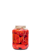 A jar of pickled peppers prepared for the winter by a peasant farmer, Botiza, Maramures, Romania