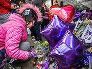"22 APRIL 2016 - MINNEAPOLIS, MN: MINA LEIERWOOD, from Minneapolis, MN, at the memorial for Prince in front of 1st Ave in Minneapolis. She said listened to Prince's music all through high school. Thousands of people came to 1st Ave in Minneapolis Friday to mourn the death of Prince, whose full name is Prince Rogers Nelson. 1st Ave is the nightclub the musical icon made famous in his semi autobiographical movie ""Purple Rain."" Prince, 57 years old, passed away Thursday, April 21, 2016, at Paisley Park, his home, office and recording complex in Chanhassen, MN.   PHOTO BY JACK KURTZ"